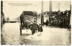 Paris Under the Waters: Saving the Furniture (1910) (postaletrice) Tags: street old boy paris france water seine work vintage de wagon geotagged photo ledefrance cityscape power flood antique postcard crowd transport working hard relief antigua human transportation carro cape postal 1910 transports foule cart char removal emergency mudanza secours enfant pulling nio francia quai postale inondation carte transporte ancienne flooded sena crue dmnagement passy tarjeta humana traslado carreta charrette cpa inundada humanpowered belleepoque inundacin muchedumbre traccin crecida inond geo:lon=488478 geo:lat=22751