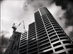 the great southbank dream (mugley) Tags: sky blackandwhite bw building 120 film architecture modern clouds skyscraper mediumformat construction 645 fuji apartment curves grain australia melbourne victoria southbank cranes balconies epson neopan400 polarizer 6x45 residential mamiya645 urbanlandscape redfilter multiplex polariser 25a v700 keystoning mamiya645protl m645 powerst fujifilmneopan400 35mmf35sekorn southbanktowers southbankone centralequity