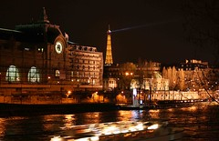 The d'Orsay and the Eiffel Tower from the River Seine (J K Johnson) Tags: light motion paris france color reflection clock monument water beautiful beauty museum architecture night reflections river boat interesting colorful downtown glow eiffeltower style eiffel architectural explore trainstation laser handheld romantic nightscene dorsay dorsey museumcity towerdorsey