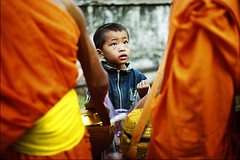 monk's assistance (Monpeera) Tags: kids temple culture monk tradition laos smilling laungprabang laoskids laosgirl