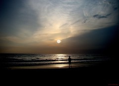 looking at the Sun....Calicut (aroon_kalandy) Tags: light boy sunset sea sky india beach nature beauty photoshop landscape creativity evening adobephotoshop artistic awesome thoughtful son kerala fantasy fancy greatshot looks impressions lovely majestic fantstica naturelovers calicut kozhikode sihloutte supershot topshots beautifulshot anawesomeshot calicutbeach sonydslra200 malayalikkoottam worldwidelandscapes kozhikodebeach sonyh50 aroonkalandy calcutbeach