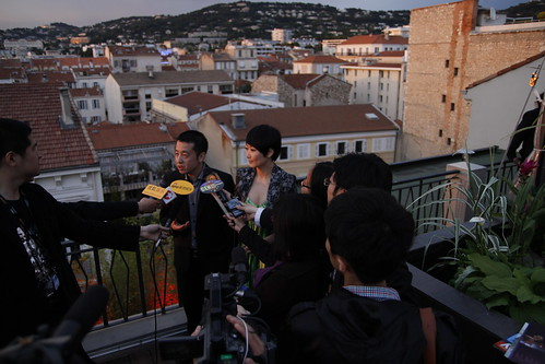 Jia Zhangke and Zhao Tao being interviewed