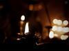 Lamps and silhouettes (Sudhamshu) Tags: light silhouette festival fire bokeh desaturated lamps demotivator vignette 50mmf14 diya vishukani