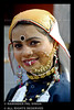 Artist from UK (Raminder Pal Singh) Tags: uk portrait woman sun india girl beauty smile face lady happy necklace dance eyes artist photographer dof artistic joy culture photojournalism lips clothes 1d shade beautifulwoman nosering lipstick punjab amritsar beautifulgirl nath headgear attire worldculture canon1d indianculture uttarakhand lippaint indiatraditional kumou 14thnationalyouthfestival