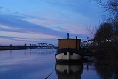 Boat on ijssel (10953) (roserosa) Tags: bridge holland river evening boat ijssel rivier woonboot