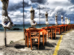 ... (Theophilos) Tags: sea beach clouds landscape restaurant chairs greece crete tavern tables umbrellas chania