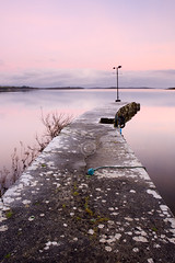 Lough Corrib Pier, County Galway, Ireland. (dougchinnery.com) Tags: pink ireland winter copyright irish galway sunrise landscape dawn pier still frost frosty quay stillness windvane loughcorrib thefatcat44 dougchinnery oughterrard