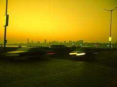 Evening At Marine Drive (Shuuro) Tags: cameraphone sunset sea people orange india water colors car yellow skyline photoshop evening twilight traffic maharashtra mumbai marinedrive girgaum imobile902