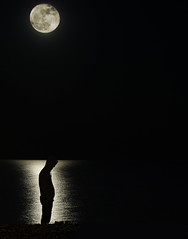 moon child (ssj_george) Tags: leica light sea portrait moon man black reflection beach water night standing dark lumix person rocks alone darkness horizon cyprus panasonic solo single edge thinking hood 1001nights moonshot larnaca nighshot platinumheartaward   fz28