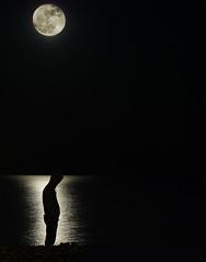 moon child (ssj_george) Tags: leica light sea portrait moon man black reflection beach water night standing dark lumix person rocks alone darkness horizon cyprus panasonic solo single edge thinking hood 1001nights moonshot larnaca nighshot platinumheartaward   fz28