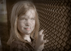 Charlotte at 8 (lgflickr1) Tags: 2010 norfolk virginia child girl cute shadow pattern smile blond fence charlotte candid street chainlink dusk mischievous curious lateafternoon sepia nikon d700 247028 portrait spring bridge overpass chainlinkfence longshadow young kid pretty outdoor youth us58 midtowntunnel underpass hamptonroads city