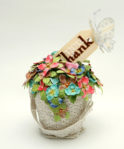 Lace bucket with flowers and a tag