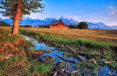 Morning Light on the Shallow Stream (Jeff Clow) Tags: ranch morning barn landscape bravo stream farm explore western wyoming tetons frontpage gar grandtetonnationalpark jacksonholewyoming thomasmoultonbarn