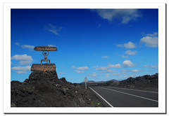 Timanfaya. Lanzarote.- (ancama_99(toni)) Tags: ocean road trip travel blue light sunset sea vacation sky espaa paisajes naturaleza mountain holiday mountains color beach nature azul clouds landscape geotagged photography mar photo interestingness interesting spain nikon espanha europa europe foto carretera photos lanzarote playa paisaje canarias photographic bleu explore cielo fotos canary 1855mm roads blau fotografia nikkor paysage espagne paesaggi canaryislands 2009 islas spanien paisagens islascanarias yaiza fotografas timanfaya d60 carreteras azl nikkor1855 explored nikond60 landschaftsaufnahmen holidaysvacanzeurlaub ancama99 colourartaward interesantsimo flickrlovers