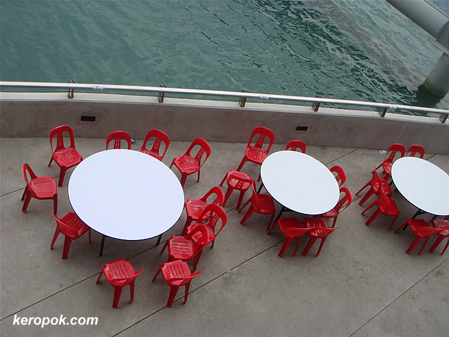 Red chairs and empty tables