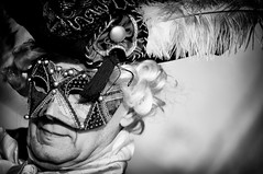 Mask5 (DoctorTac) Tags: street city carnival venice portrait people urban blackandwhite bw italy white man black male hat closeup photoshop portraits outdoors nikon italia day mask outdoor head hats bn fantasy heads nikkor performer teste carnevale venezia ritratti bianco ritratto nero biancoenero cappello maschera testa fotoritocco maschio cappelli blackwhitephotos streetcharacter ritrattorubato d700 streetactor attoredistrada silverefexpro