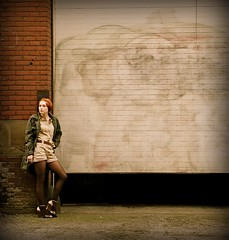 The City (Jade M. Sheldon) Tags: street city woman brown selfportrait me fashion oregon self pose portland gold graffiti belt downtown coat bricks khaki tights jade sp pearldistrict heels pdx universe onepiece redhair humans olivegreen epictetus belovedones jademsheldon