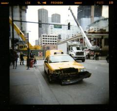 big yellow taxi (Lisa Rene) Tags: chicago yellow holga accident taxi bumper mediumformatcamera