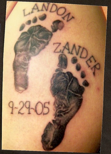 baby feet tattoo. Baby foot prints