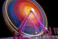 top of the midway (pbo31) Tags: california longexposure carnival pink blue red usa motion black color june night dark lights oakland movement lowlight nikon ride magenta fuchsia fair bayarea eastbay d200 funfair 2009 alamedacounty lightstream urbanarea coliseumindustrial