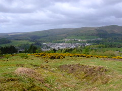 LOOKING OVER LANGHOLM.  02 (the water watcher 05.) Tags: wood trees houses summer sky cloud brown white tree green yellow skyline clouds rural buildings landscape grey scotland landscapes countryside town woods skies village view heather hill gray may hills views vista moors bracken summertime moor becks stormysky rollinghills borders greysky moorland gorse caulfield stormyclouds dumfriesandgalloway holmwood greyclouds countryscene greyskies whins dumfriesshire langholm ruralscene hilltops gaskells fujifinepixs5600 whita furse thebecks holmewood whitahill themuckletoon midhill timpen meikleholmhill thelangholmwalks wauchopevalley langholmgolfcourse ruralvista dumfriesshirehills