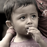 Indonesia, Bali. Little candy eater.