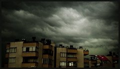 A storm is coming (Melissa Maples) Tags: sky storm reflection clouds buildings turkey grey nikon asia apartments widescreen flag trkiye antalya nikkor 169 turkish vr afs  18200mm   f3556g d40  18200mmf3556g