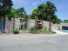 Rundown houses in downtown Kingston, Jamaica (bbcworldservice) Tags: world school girls boys gardens tivoli town athletics downtown assignment champs christopher coke lord kingston bbc jamaica drug service 2010 denham dudus