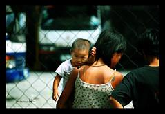 Sinking (maraculio) Tags: street boy baby art photography child mother photowalk indios sinking jarsofclay flickristasindios maraculio