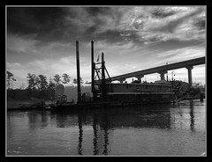 Old Construction Barge (sailingmorgans) Tags: ocean bridge sea blackandwhite water reflections boats ray sailing northcarolina coastal morgan barge dredging workingboat adamscreek marineconstruction commercialboat