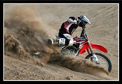 KJ Berm_01 (Miserlou) Tags: california blue red sun color canon honda jump sand desert action air bikes hills dirt riding motorcycle kj the sports 4 action stroke playground ocotillo wells