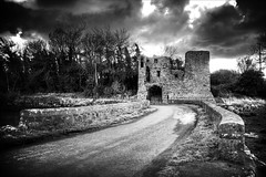 Black and White Gatehouse (Etrusia UK) Tags: uk trees blackandwhite castle castles clouds photoshop buildings landscapes nikon unitedkingdom wideangle northernireland paths ni walls hdr wmp pictureperfect ulster gatehouse strangfordlough nikkorlens codown 18200mm photomatix nikonlens vrlens nikon18200mm nikkor18200mmvr 5xp nikkor18200mm nikon18200mmvr 18200mmlens nendrummonasticsite wanderinggypsies daarklands