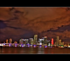 Downtown Miami skyline at night { Explored } (canmom ( Carrie )) Tags: city longexposure nightphotography fab sky holiday seascape skyline night clouds landscape downtown florida miami miamibeach hdr southflorida biscaynebay watsonisland downtownmiami portofmiami macarthurcauseway purplebridge mywinners abigfave diamondclassphotographer theperfectphotographer