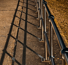 Shine And Shadows (©Komatoes) Tags: uk shadow abstract beach fence concrete photography photo sand shadows shine geometry steel picture angles minimal explore driftwood devon photograph railing railings stainless teignmouth 316
