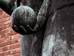 Play ball (Eva the Weaver) Tags: sculpture brick stone wall ball globe hand sphere sculpted