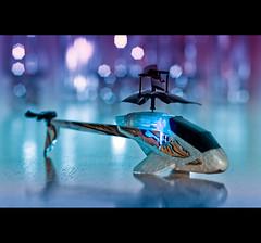 Ready For Take Off (Strobist bokeh) (©Komatoes) Tags: blue color colors 50mm lights chopper nikon colours purple bokeh 11 led explore helicopter fp takeoff d40 strobist nikond40 picturesocial 247bokehlife strobistbokeh nosexdrugsorrocknroll