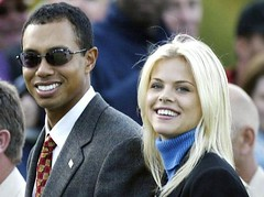 SUTTON COLDFIELD - SEPTEMBER 26:  Golfer Tiger Woods poses with girlfriend Elin Nordegren during the opening Ceremony for the 34th Ryder Cup on September 26, 2002 in Sutton Coldfield, England. (Photo by Andrew Redington/Getty Images)