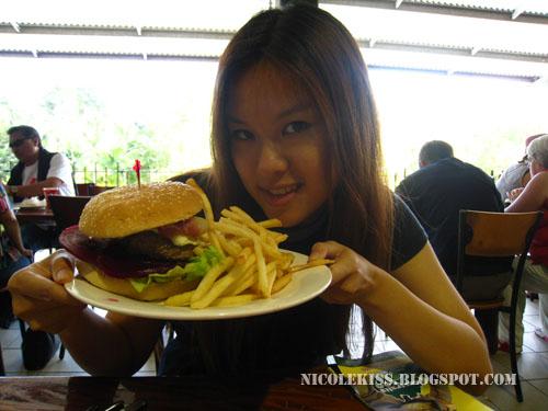 me holding my burger
