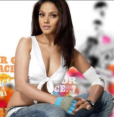 Neetu Chandra posing in jeans and white bra