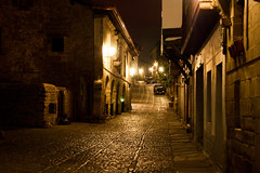 Santillana del Mar 01 (Spain) (Kaptah) Tags: street old stone night canon eos noche calle antique cobbled paving nocturna viejo antiguo cantabria santillana piedra empedrado santillanadelmar adoquinado kartpostal photographyrocks 400d platinumheartaward flickrunitedaward gettyimagesiberiaq12012