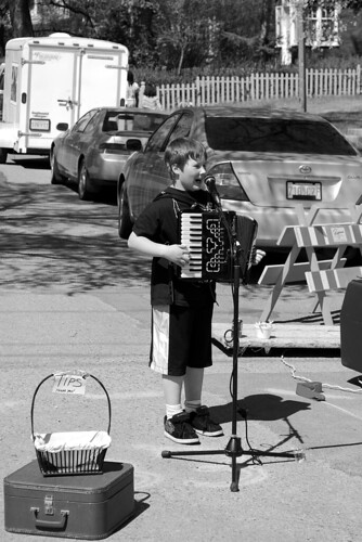 Cathedral Village street fair accordion player