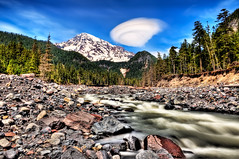 Rainier River (Surrealize) Tags: seattle blue sky cloud white mountain snow tree water pine creek river volcano moving nationalpark log nikon rocks stream paradise bank boulder ufo glacier dirt evergreen washingtonstate majestic mtrainier lenticular hdr embankment rushing cougarrock d700 surrealize
