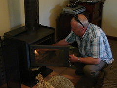 Man At Work (mdavidford) Tags: door light chimney fire warmth heater huntervalley tatler lovedalehouse