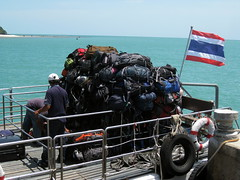 A huge pile of backpacker bags loaded onto the boat from the full moon party