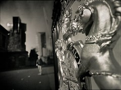 the horse's revenge (mugley) Tags: city urban blackandwhite bw horse man 120 film rollei mediumformat weird 645 gate heraldry coatofarms dof skyscrapers bokeh crane grain perspective australia melbourne wideangle victoria negative epson wtf polarizer unicorn 6x45 r3 mamiya645 bloke redfilter polariser urbanfragment williamst 25a id11 v700 mamiya645protl melbournecentraltower ilfotec m645 rolleir3 republictower legalprecinct formerroyalmint labanque 35mmf35sekorn probablyaconstructionworker