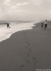 FootPrints (rohini_kamath) Tags: sea blackandwhite copyright india beach water shoe sand footprints chennai incredible tamilnadu reebok rohini enchanting kamath ifornature rohinikamath