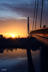 Nevena Uzurov - Bridge over quiet river (Nevena Uzurov) Tags: bridge light sunset sun colors clouds reflections river landscape evening scenery colorful quiet serbia silhouettes goldenhour sava vojvodina srbija  sremskamitrovica  srem     stirineybridge venkane  nevenauzurov