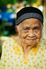 My Grandma (wazari) Tags: life old grandma portrait people blur art face person 50mm golden nikon mood dof emotion artistic bokeh expression availablelight live character nanny naturallight charm persona