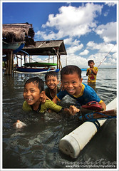 Little Fisherman Smile (myudistira) Tags: bali playing smile work children fishing photographer child play culture made 2009 freelance adat budaya balinese fotografer unik yudis baliview baliphotographer yudistira myudistira madeyudistira yudist