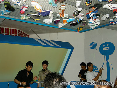 Adidas sneakers stuck to the ceiling